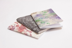 Hand drawn pocket size notebooks.